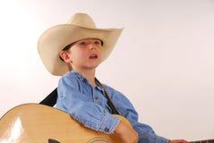 hatt för pojkecowboygitarr Arkivbild
