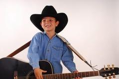 hatt för pojkecowboygitarr Royaltyfri Fotografi