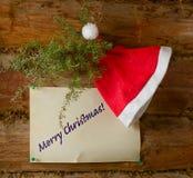 Hatt Santa Claus, en filial av en och ett stycke av papper med t Royaltyfria Foton