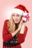 hatt som rymmer den aktuella santa kvinnan Fotografering för Bildbyråer
