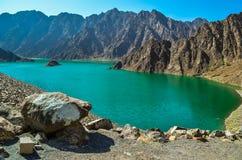 Hatta Dam Green Lake. Between mountains in Dubai, United Arab Emirates Stock Image
