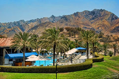Hatta Hotel. A hotel pool with mountains in the background Stock Photo