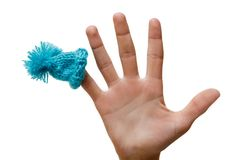 Hattblått på ditt finger, jul blidkar, isolerat objekt locknolla Royaltyfri Bild