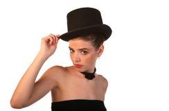 hatten poserar överkanten royaltyfri foto