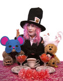 Hatter and Friends Tea Party. Alice in Wonderland Costume Party with the characters Mad Hatter, DoorMouse, March Hair and Cheshire Cat royalty free stock photography
