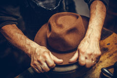 Hatter making a hat Royalty Free Stock Photo
