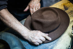 Hatter making a hat Royalty Free Stock Image