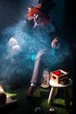 A hatter with red hair in smoke clubs Royalty Free Stock Photography