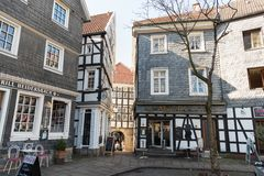 HATTINGEN, GERMANY - FEBRUARY 15, 2017: Many of the historic houses have retail shops in their ground floor and attract local shop. Pers and tourists stock image