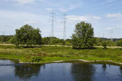 Hattingen (Germany) - Landscape with River Ruhr, trees and power poles. A landscape with the Ruhr River, trees and power poles below the Castle Isenburg in Stock Photography
