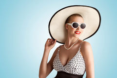 The hatty elegance. A lovely photo of pin-up girl in vintage hat Royalty Free Stock Photo
