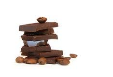Haufen der Schokolade und der Kaffeebohnen Stockfotos