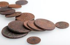 Haufen der sehr alten Kupfermünzen Lizenzfreie Stockbilder