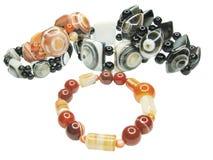 Haufen des farbigen jewelery Lizenzfreie Stockbilder