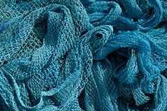 Haufen des Netzes der kommerziellen Fischerei. Lizenzfreie Stockfotografie
