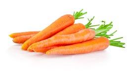 Haufen von den Karotten lokalisiert auf weißem Hintergrund Stockfoto