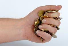Haufen von Münzen in der Hand Lizenzfreies Stockbild