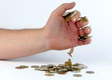 Haufen von Münzen in der Hand Stockfotografie