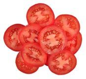 Haufen von Tomatenscheiben auf einem Weiß lizenzfreie stockfotografie