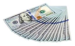 Haufen von US-Dollar auf weißem Hintergrund Stockfotografie