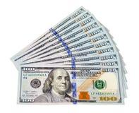 Haufen von US-Dollar auf weißem Hintergrund Lizenzfreies Stockbild