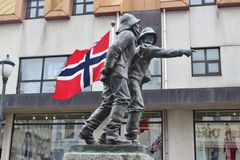 HAUGESUND, NORWAY – AUGUST 7, 2015: Statue of two fishermen in the center of Haugesund. Royalty Free Stock Images