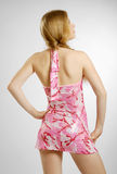 Haughty blonde in pink. A teenage girl is conceited. She is standing back. Her head is tossed proudly. She is wearing a short pink dress royalty free stock photo