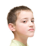 Haughty face,. Little boy poses against white background Royalty Free Stock Image
