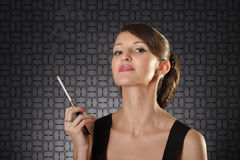 Haughty lady. Attractive haughty lady with cigarette over dark background Royalty Free Stock Photos