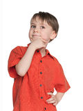 Haughty little boy. A portrait of a haughty little boy on the white background Royalty Free Stock Images
