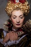 Haughty queen. Picture of beautiful haughty queen in royal dress Royalty Free Stock Photo