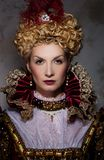 Haughty queen. Picture of beautiful haughty queen in royal dress Royalty Free Stock Image