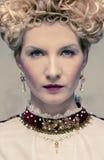 Haughty queen. Portrait of beautiful haughty queen Royalty Free Stock Photos