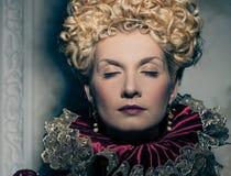 Haughty queen. Portrait of beautiful haughty queen Royalty Free Stock Images
