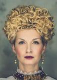 Haughty queen. Portrait of beautiful haughty queen in royal dress Royalty Free Stock Photo