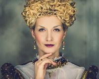 Haughty queen. Portrait of beautiful haughty queen in royal dress Stock Photography