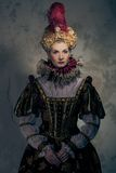 Haughty queen. In royal dress Royalty Free Stock Images