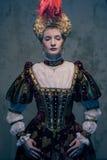 Haughty queen. In royal dress Stock Images