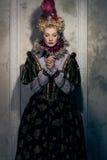 Haughty queen. In royal dress Stock Photo