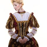 Haughty queen. In royal dress isolated on white Stock Photography