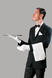 Haughty waiter. Holding an empty tray to place your product Stock Images