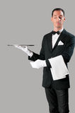 Haughty waiter. Holding an empty tray to place your product Royalty Free Stock Image