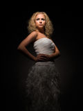 Haughty. Woman in luxury dress Royalty Free Stock Image