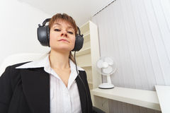 Haughty woman - producer with ear-phones Stock Photo