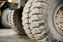Haul dump truck tire close up. Haul dump truck tyre tire close up Stock Photos