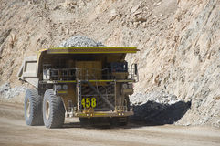 Haul truck carries waste rock in the Chuquicamata copper mine stock images