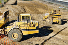 Hauler and Bulldozer on Construction Site Stock Photography