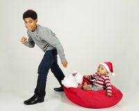 Hauling Baby on Santa's Sack Stock Image