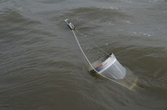 Hauling inboard a plankton net Stock Photography