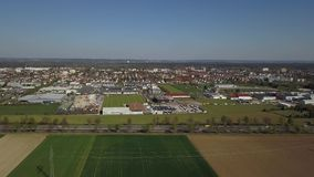 Haunstetten, a suburb of Augsburg in Germany. Aerial drone footage of Haunstetten, a suburb of Augsburg in Germany. View over the federal Highway B17 towards the stock video footage